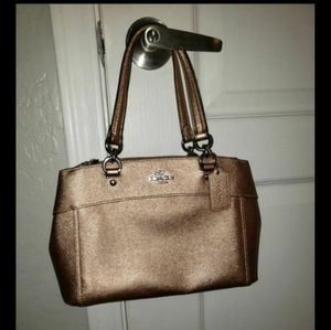 Rose gold Coach purse
